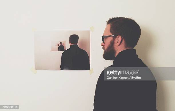 Reflection Of Mid Adult Man On Mirror At Home