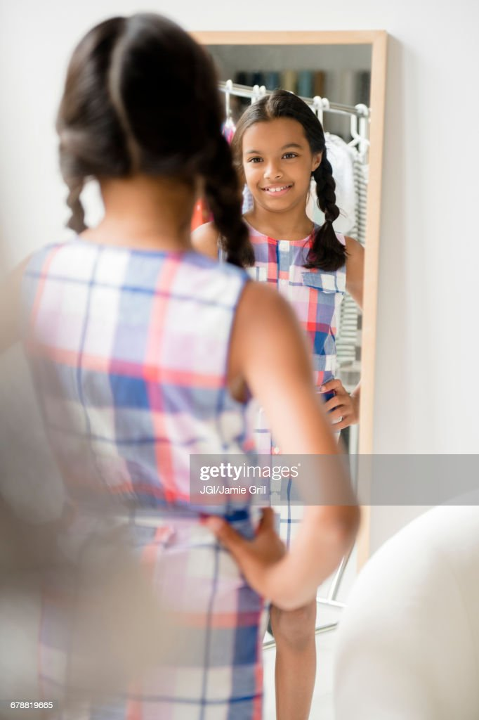 Reflection of Mixed Race girl in mirror : Stock Photo