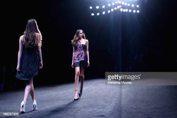 A reflection of models showcasing designs on the runway at the Suboo show during MercedesBenz Fashion Week Australia Spring/Summer 2013/14 at...
