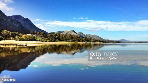 Reflection of mountain and cloudy sky in lake