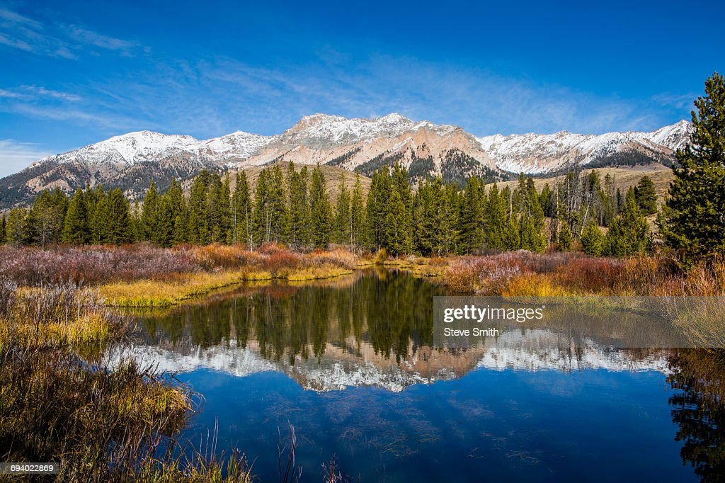 Reflection of mountain in river : Stock Photo