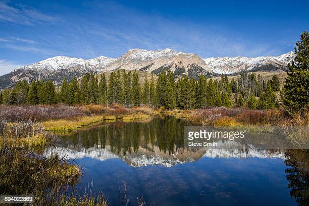 reflection of mountain in river - sun valley idaho stock photos and pictures