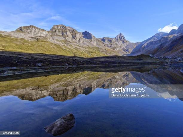 reflection of mountain range in lake - schwyz stock pictures, royalty-free photos & images