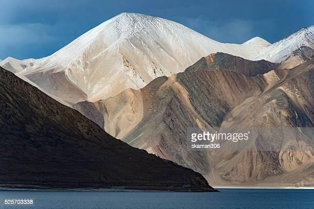 reflection of mountain range on the way to pangong lake Ladakh