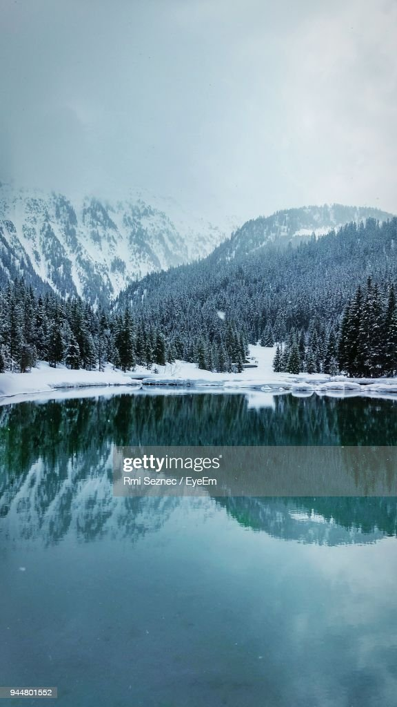 Reflection Of Mountains In Lake During Winter : Stock Photo