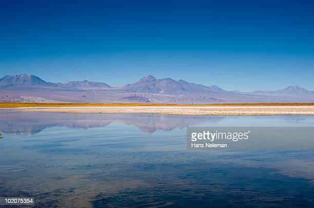 Reflection of mountains in water, Laguna Cejar, Salar De Atacama, San Pedro De Atacama, Antofagasta Region, Chile