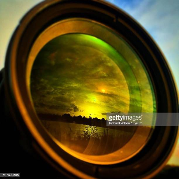 reflection of nature during sunset on camera lens - lens optical instrument stock photos and pictures