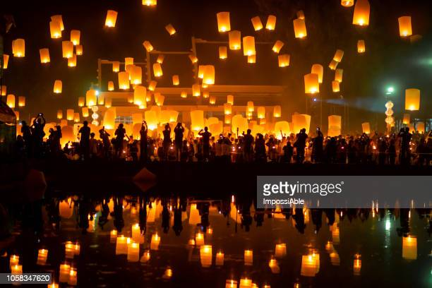 reflection of numerous lanterns in the sky, yeepeng festival , chiangmai, thailand - lantern stock pictures, royalty-free photos & images