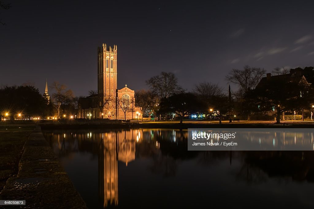 Reflection Of Old Church On Calm Lake Against Sky At Night : ストックフォト