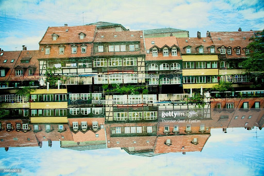 Reflection Of Old Houses On River : Stock Photo