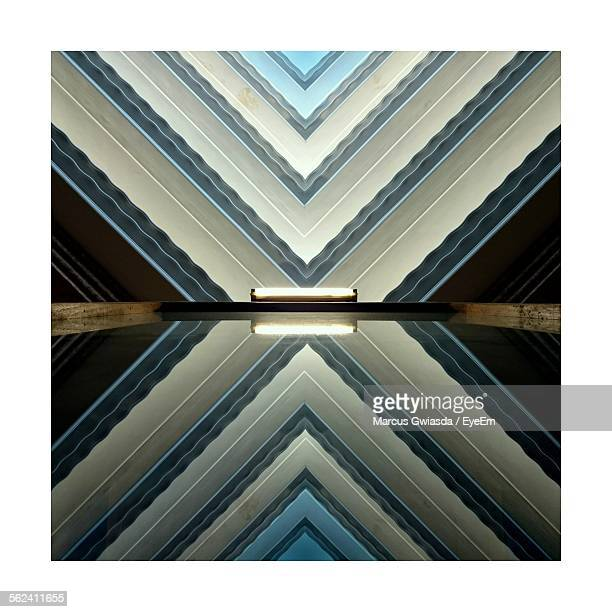 Reflection Of Patterned Wall In Water