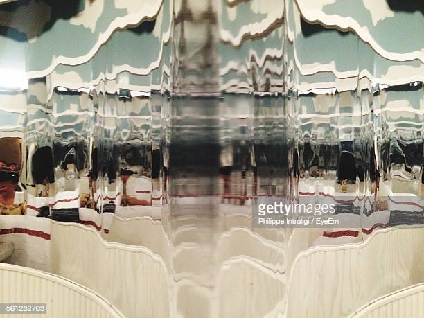 reflection of people in distorted mirror - fun house stock pictures, royalty-free photos & images