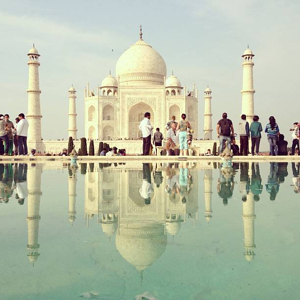 Reflection Of People In Front Of Taj Mahal Wall Art
