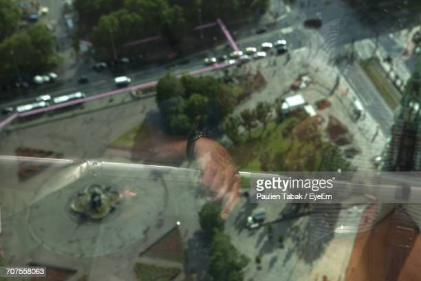 reflection of people on glass window over street at fernsehturm - paulien tabak stock pictures, royalty-free photos & images
