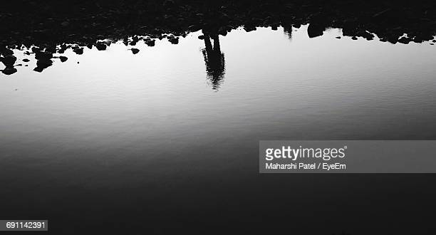 Reflection Of Person On Sea