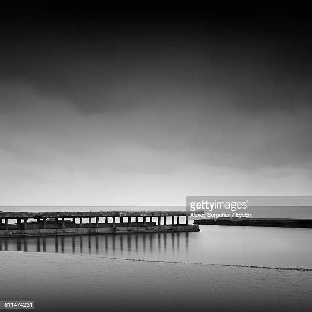 reflection of pier in sea against sky during foggy weather - ウクライナ オデッサ市 ストックフォトと画像