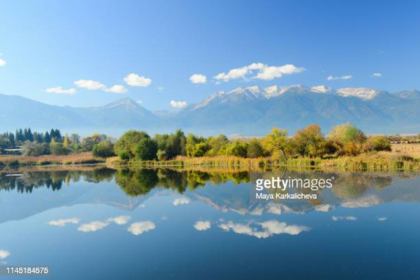 reflection of pirin mountain range in a crystal clear blue lake, bulgaria - pirin national park stock pictures, royalty-free photos & images
