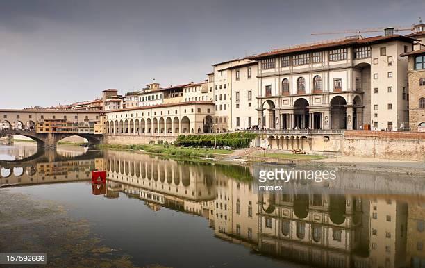 Reflection of Ponte Vecchio and Uffizi Gallery in River Arno