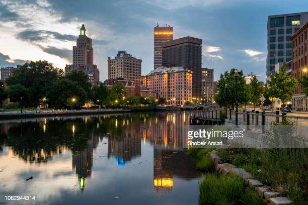 reflection of providence skyline in river  at night, rhode island - rhode island stock pictures, royalty-free photos & images