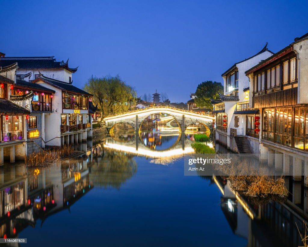 A reflection of Qibao Famous Bridge : Stock Photo