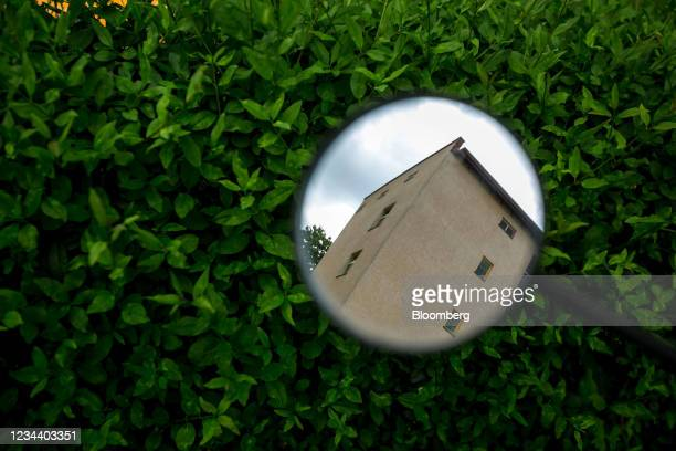 Reflection of residential apartment windows on the Carl Legien modernist housing estate, operated by Deutsche Wohnen SE, in Berlin, Germany, on...