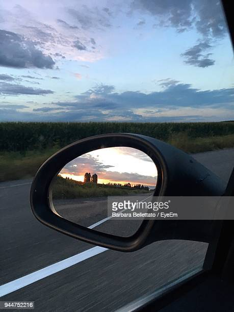 Reflection Of Road On Car Side-View Mirror During Sunset