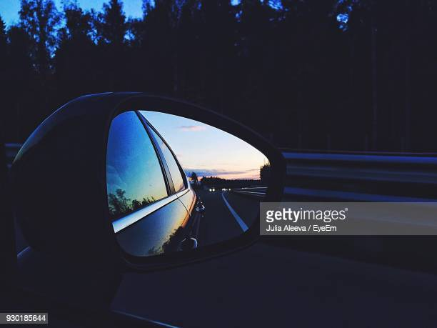 reflection of road on side-view mirror of car - side view mirror stock photos and pictures