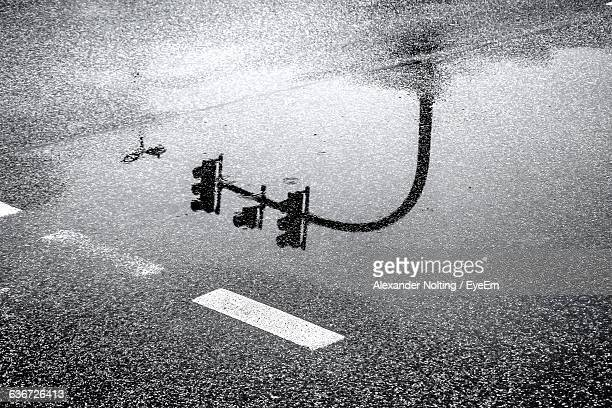 Reflection Of Road Signal On Puddle