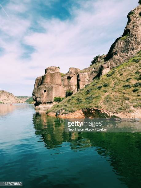 reflection of rock formation in water against sky - diyarbakir stock pictures, royalty-free photos & images