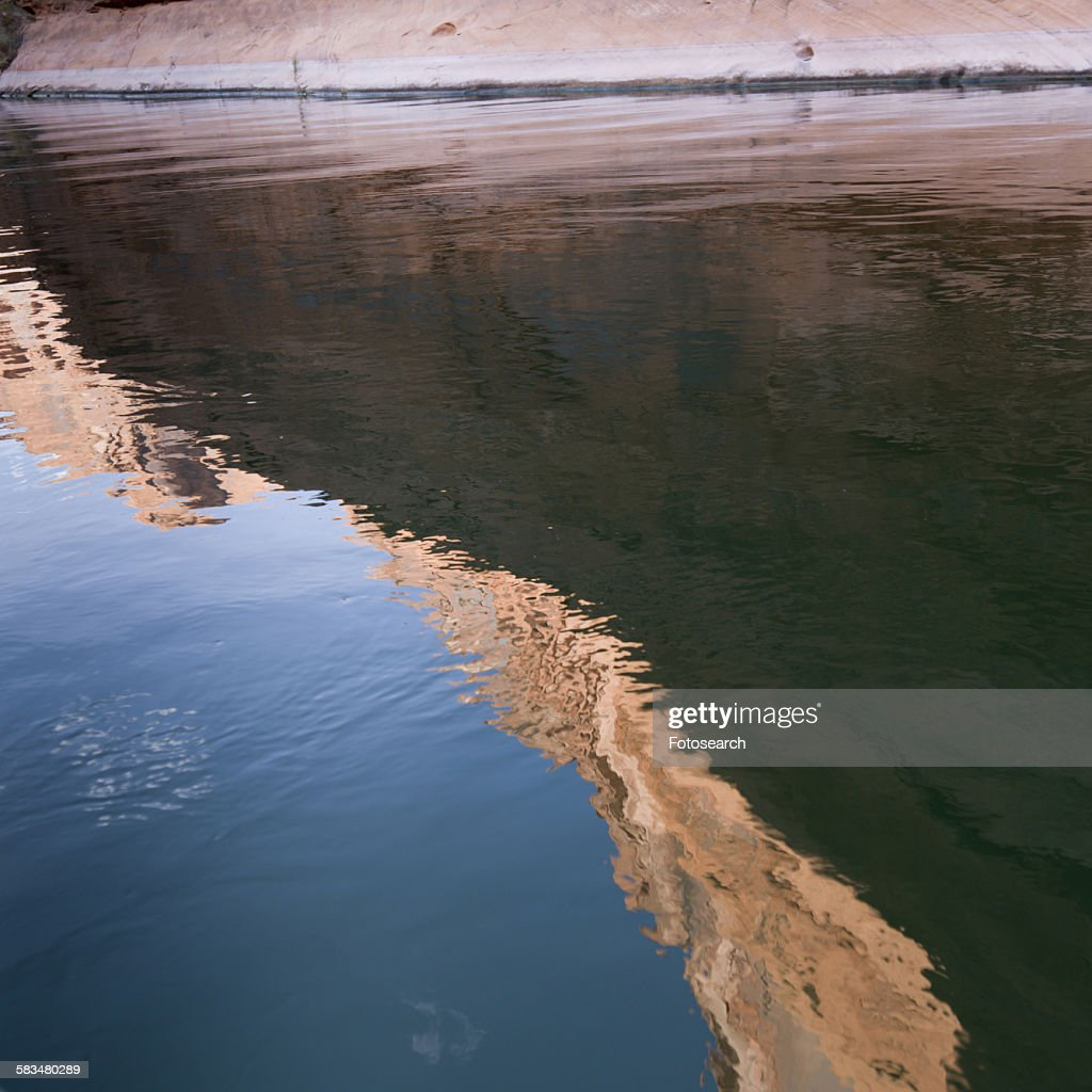 Reflection of rock in water : Stock Photo