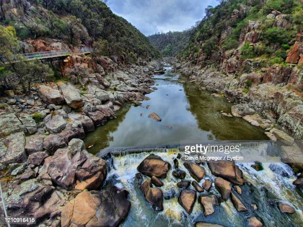 reflection of rocks and trees in river - mcgregor stock pictures, royalty-free photos & images