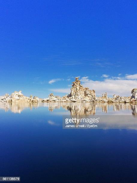 reflection of rocks on water - james oneill stock photos and pictures