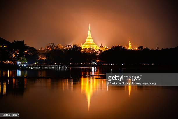 Reflection of Shwedagon Paya pagoda view from kandawgyi lake , yangon , myanmar
