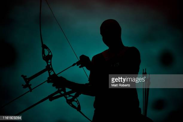 Reflection of Sjef Van Den Berg of Netherlands is seen in a puddle during the Ready Steady Tokyo - Archery, Tokyo 2020 Olympic Games test event at...
