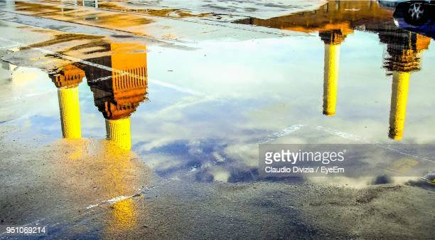 reflection of sky in puddle - battersea stock pictures, royalty-free photos & images