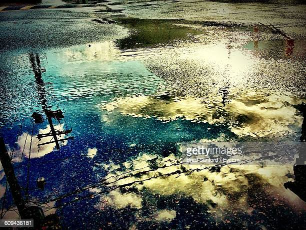 Reflection Of Sky On Puddle During Monsoon