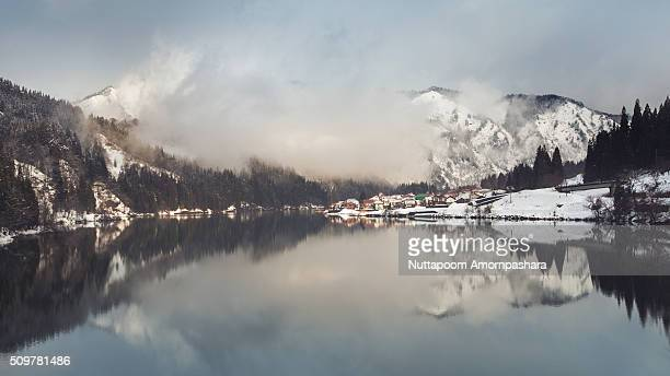reflection of snow mountain and town in mishima - mishima city stock photos and pictures