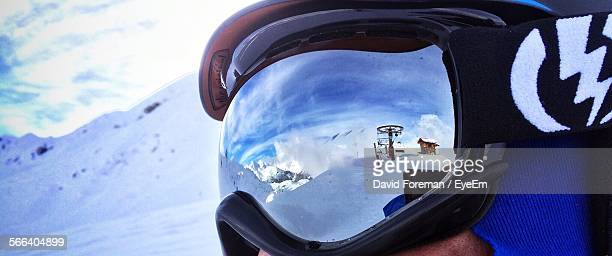 Reflection Of Snowcapped Mountains On Goggles