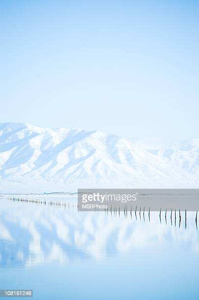 reflection of snowy mountains - great salt lake stock pictures, royalty-free photos & images