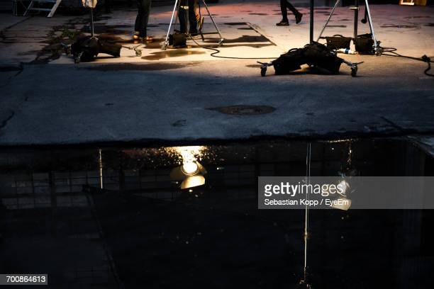 Reflection Of Spotlights On Puddle At Film Studio
