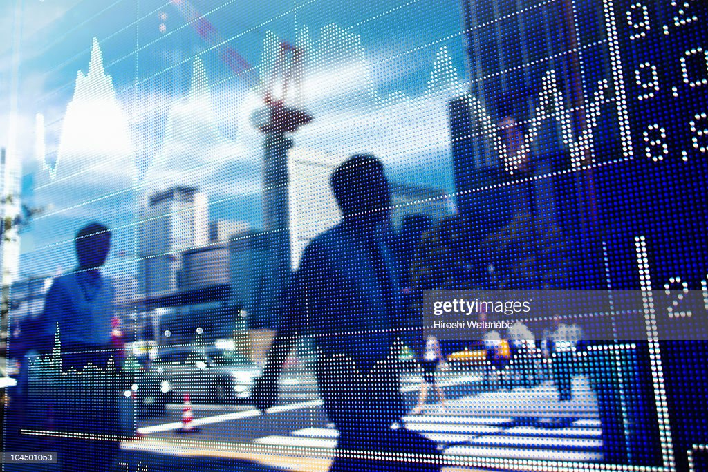 Reflection of stock market graph in window : Stock Photo