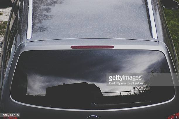 Reflection Of Storm Clouds In Car Window