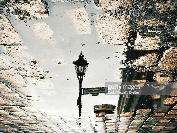 Reflection Of Street Light On Puddle During Monsoon