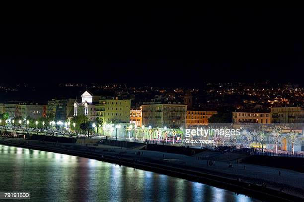 Reflection of street lights in water, Promenade des Anglais, Nice, France