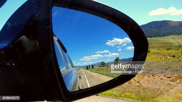 Reflection of street on car's rear view mirror