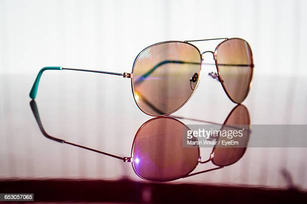 Reflection Of Sunglasses On Glass Table