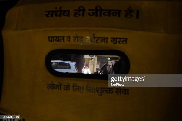 A reflection of Sunita Choudhary North India's first autorickshaw driver is seen on the mirror behind her autorickshaw with a notification that this...