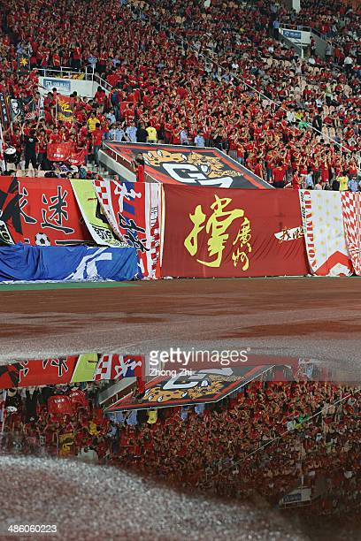 Reflection of supporters of Guangzhou Evergrande cheering during the AFC Asian Champions League match between Guangzhou Evergrande and Yokohama F...