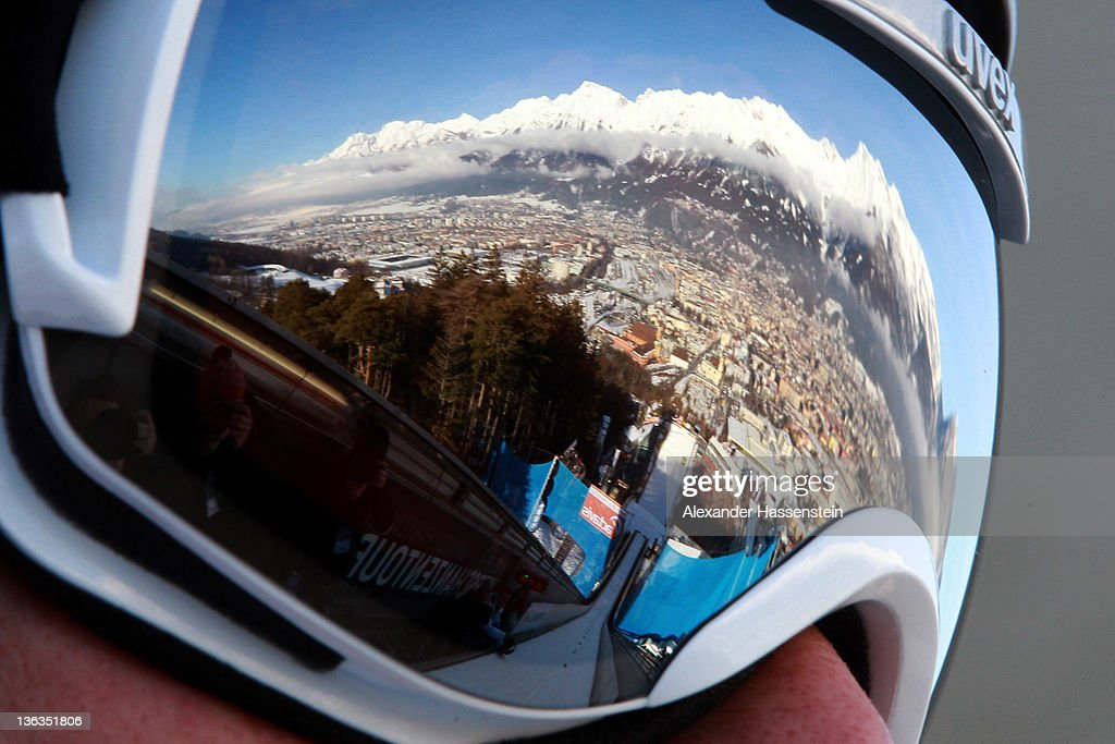 A reflection of the Alps mountain 'Nordkette' is seen in the ski googles of Anders Bardal of Norway during the training round of the FIS Ski Jumping World Cup event at the 60th Four Hills ski jumping tournament at Bergisel on January 3, 2012 in Innsbruck, Austria.