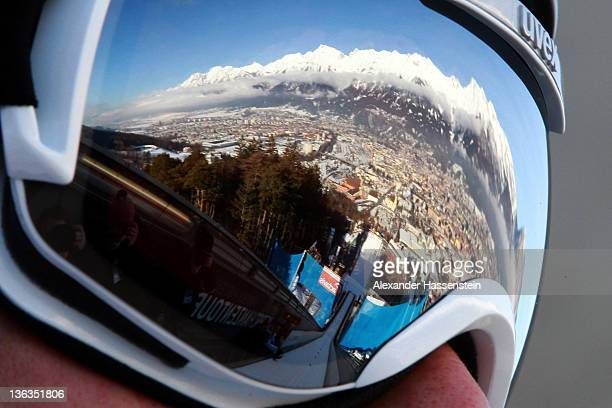 A reflection of the Alps mountain 'Nordkette' is seen in the ski googles of Anders Bardal of Norway during the training round of the FIS Ski Jumping...